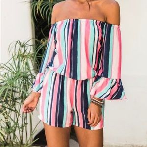 Worn once! Pink Lily multi stripped romper in MED